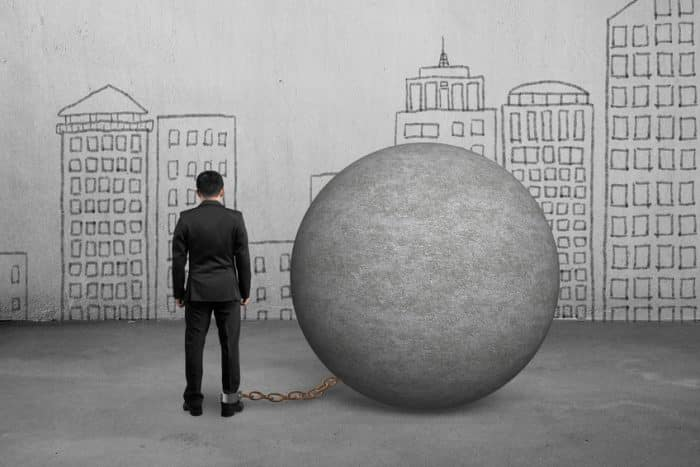 Businessman Being Trapped With Concrete Ball