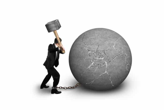Businessman Holding Hammer Hitting Cracked Concrete Ball Isolated On White